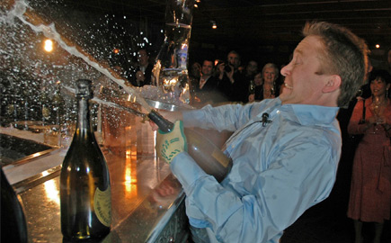 Watch Bearfoot Bistro Founder André Saint-Jacques break the Guinness World Record for the most Champagne bottles sabered in a minute in November 2005